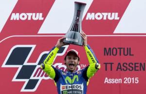 Yamaha MotoGP rider Valentino Rossi of Italy celebrates on the podium after winning the MotoGP race at the TT Assen Grand Prix at Assen, the Netherlands June 27, 2015. REUTERS/Michael Kooren